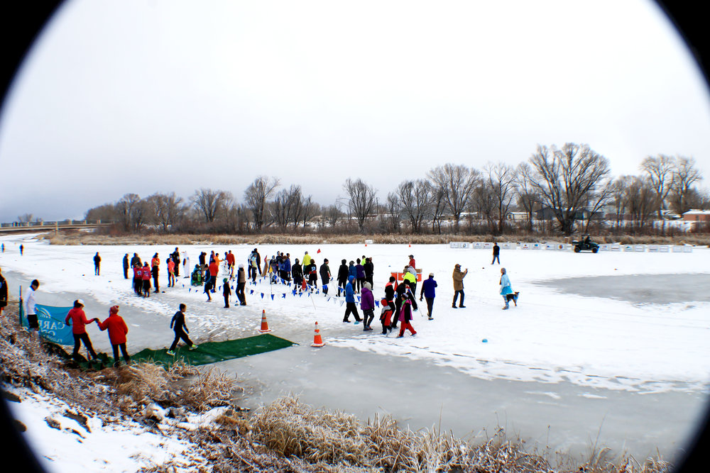 Participants gather along the starting line in the middle of the Rio Grande River.  Photo credit to Tyler G. Woods, 2015.