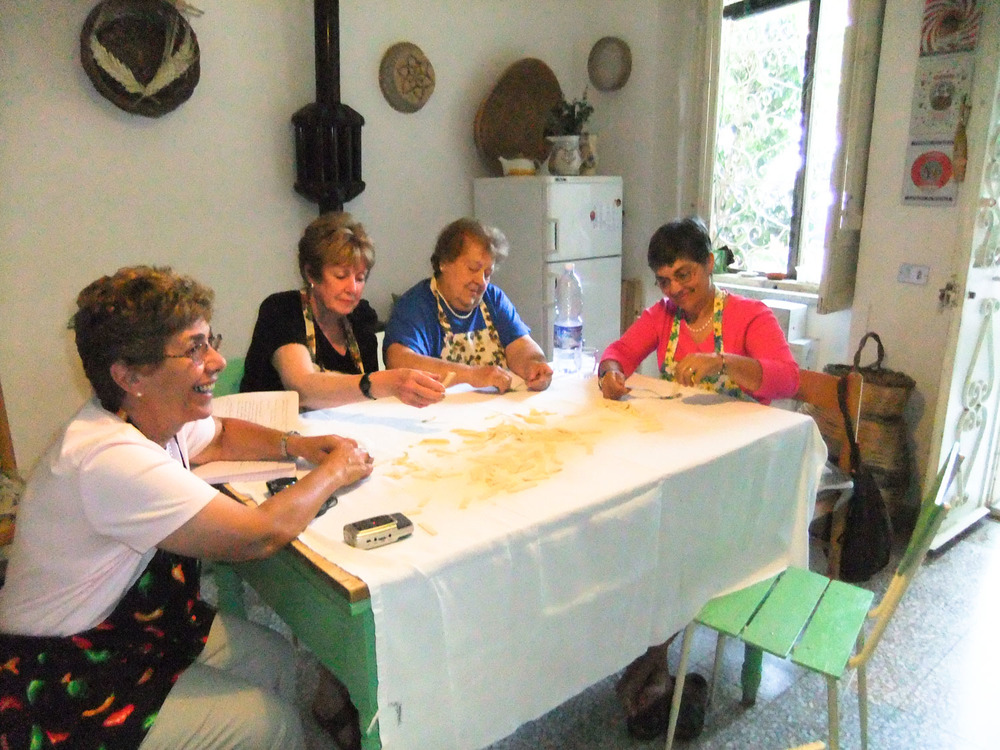 Pasta making lesson in our private group program at the villa