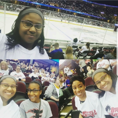 Black people don't go to hockey games? Of course we do. Me, Gina and my mini me at a Monster's game