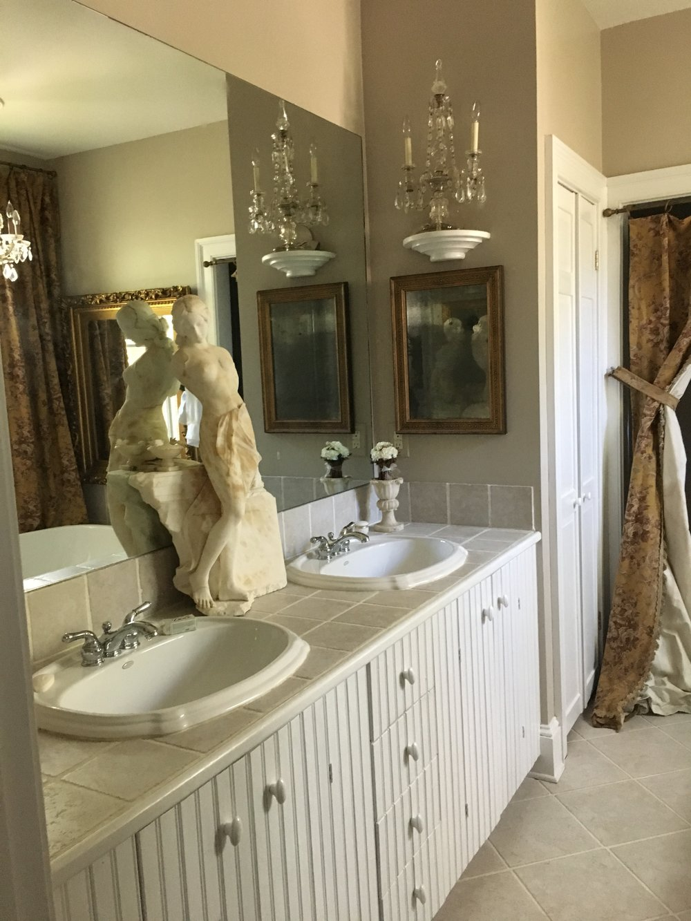 I was loving on the marble statue in the center. This bathroom is more elaborate than my entire house combined!