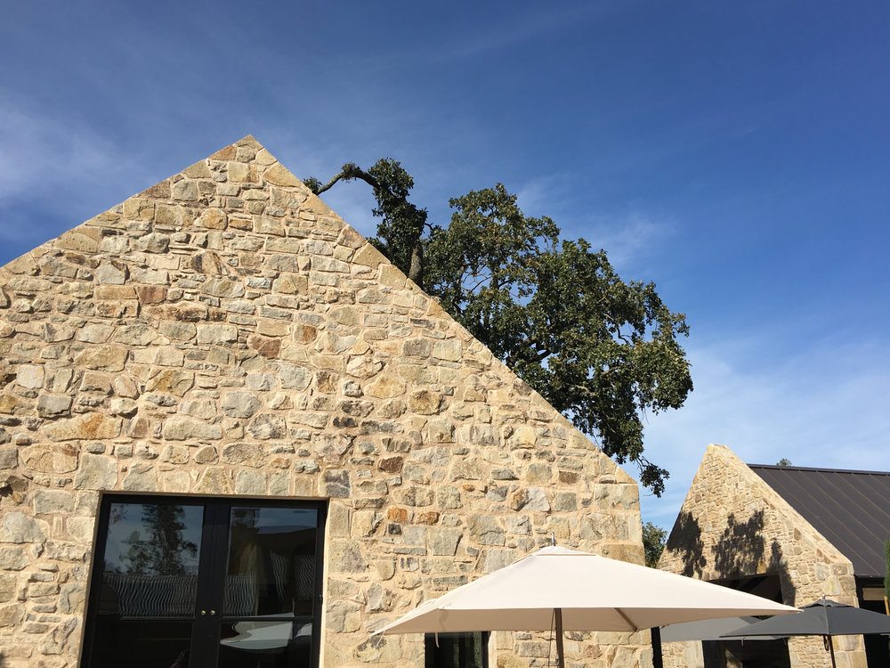 The rooflines were purposely recessed to accentuate the impressive masonry walls ( Photo: Mike Casey,The 29 Napa )