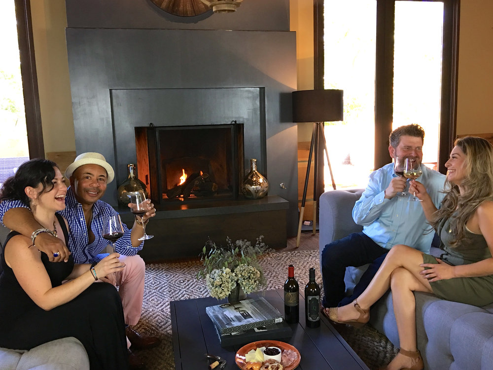 Garret enjoying some fireside time with members in the lounge( Photo: Mike Casey, The 29 Napa )