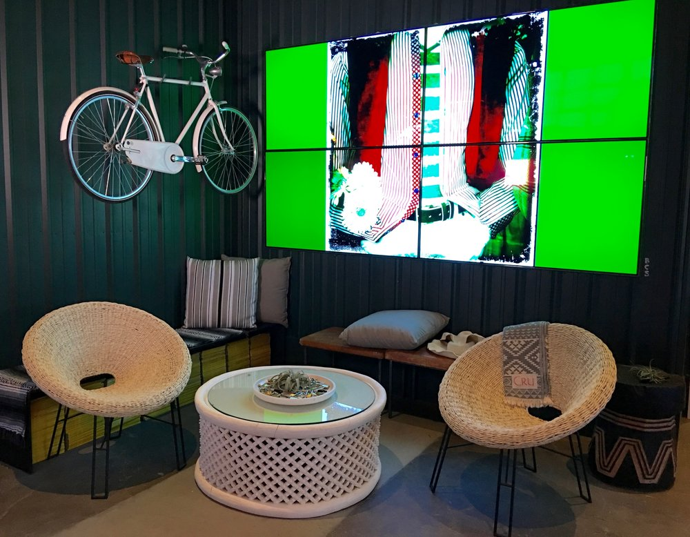 Deep green walls add to the pop of the brilliant video wall (  Photo: Mike Casey, The 29 Napa   )