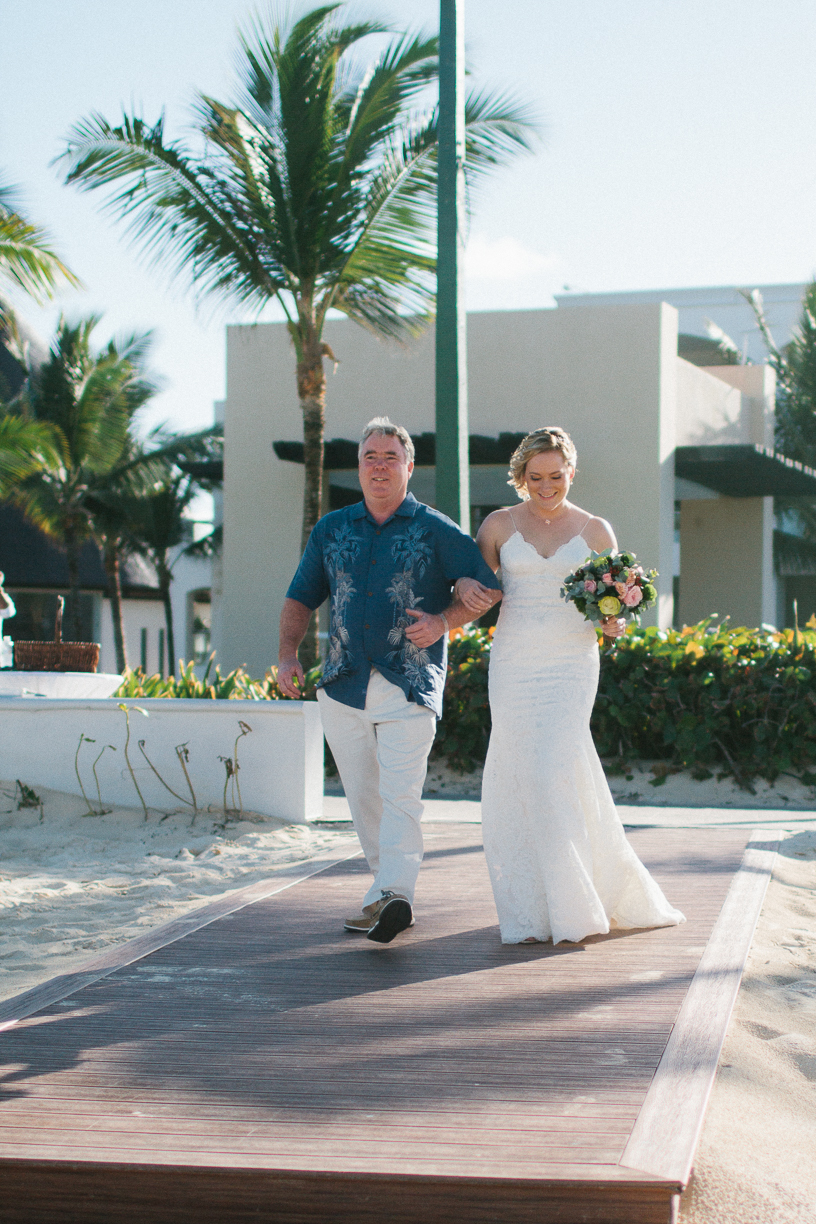 Punta Cana destination wedding, bride and father of the bride walk down aisle to beach front ceremony