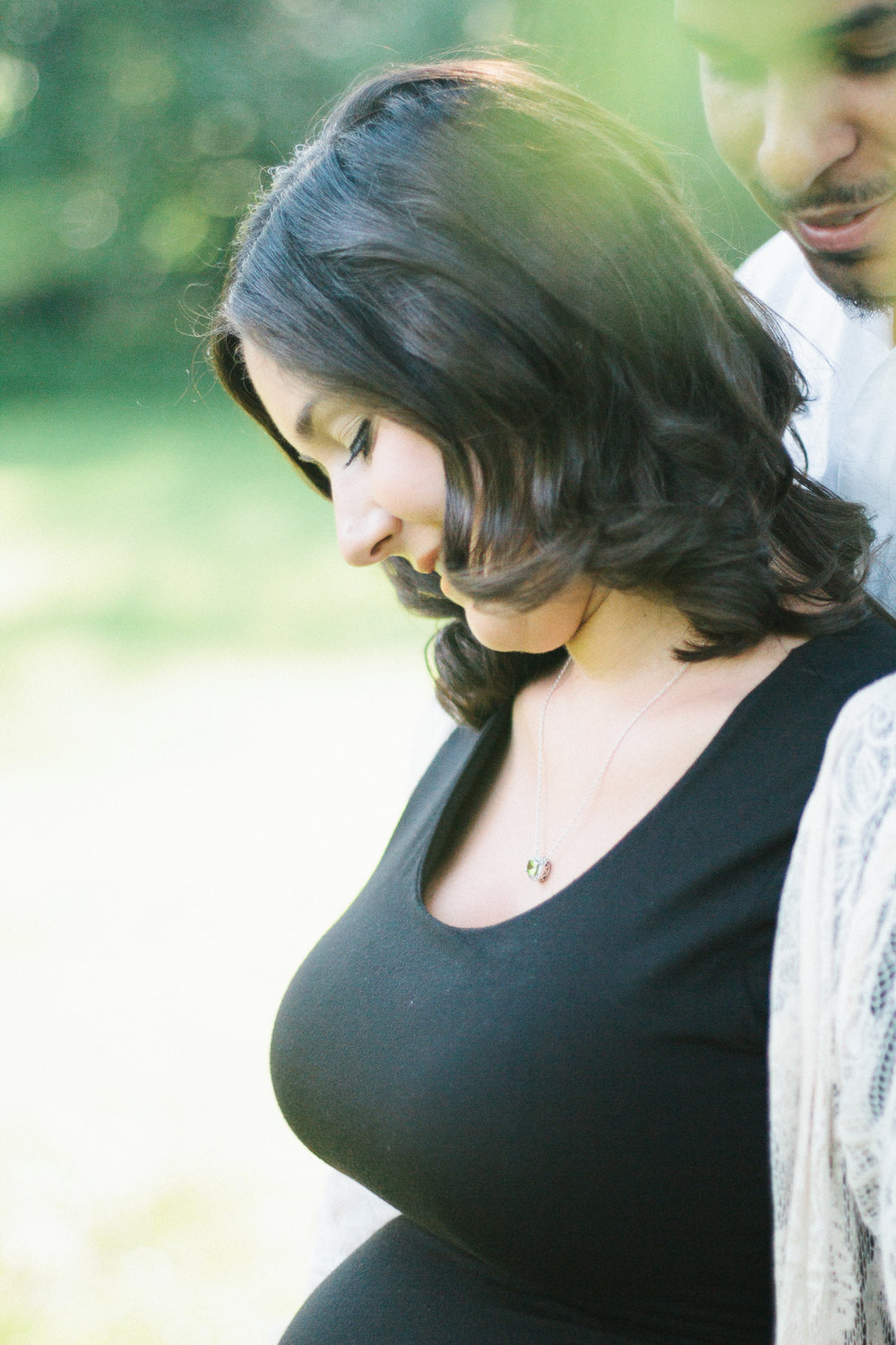 Dad looking at mom during a maternity session in Southern New Jersey photographed by Danielle Gallo Photography