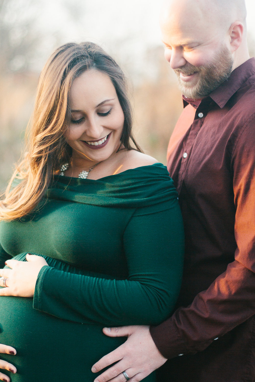 New parents sharing a loving moment, North Carolina, Danielle Gallo Photography