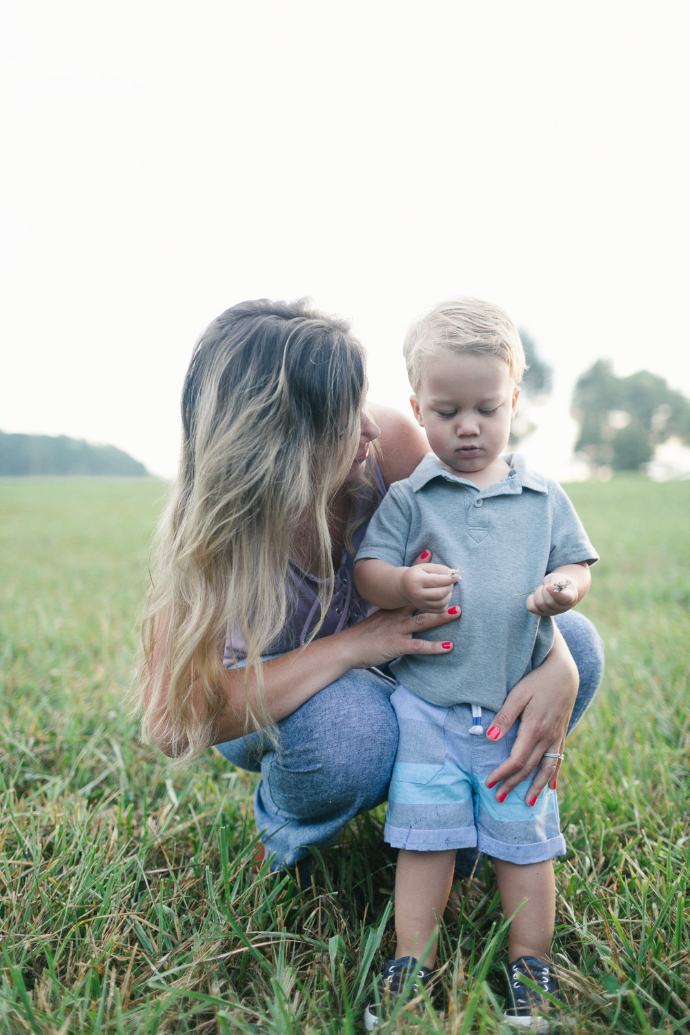 Mother playing in a field with her son, Danielle Gallo Photography, North Carolina