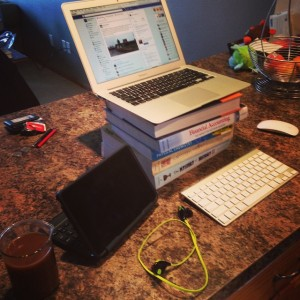 Standing desk made out of my kitchen counter top and a pile of textbooks.
