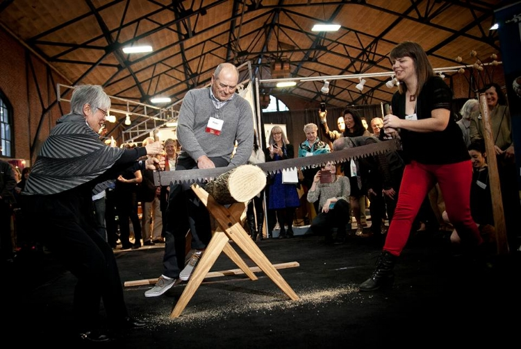 Sarah Marriage and Mira Nakashima buck a log at the kickoff of the 2016 Philadelphia Furniture Show