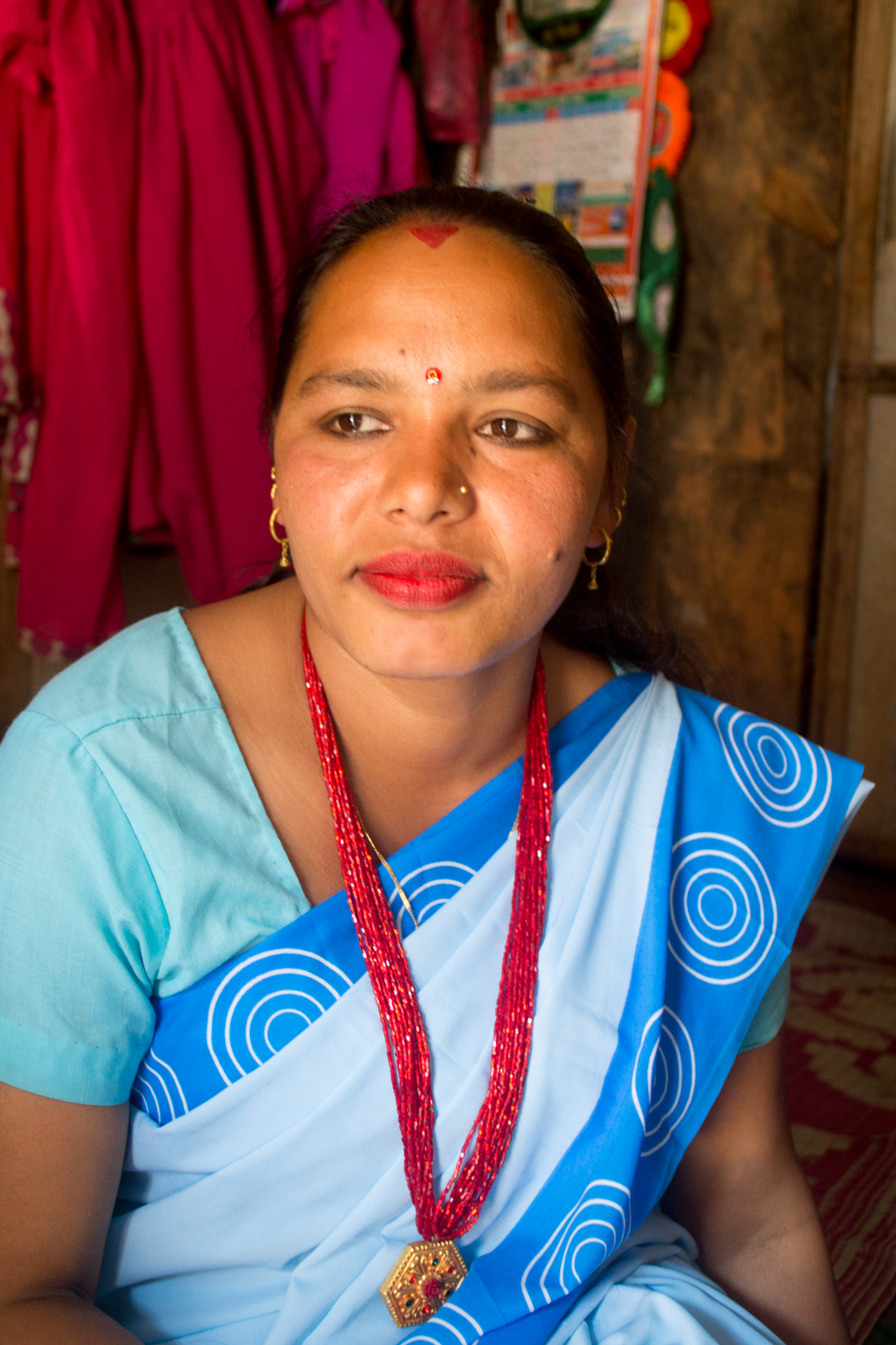 Shanti sits as she thinks back to her work as an FCHV in Sindhupalchok