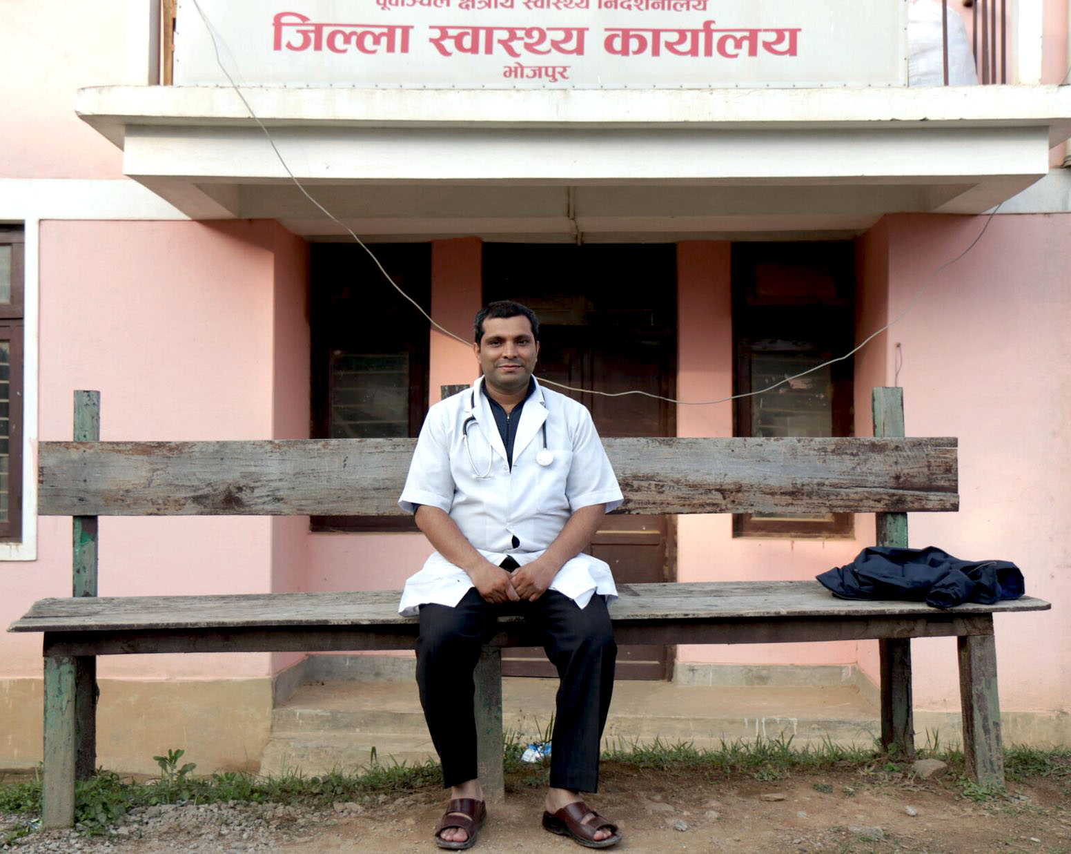 Dr. Jha, the district health officer and senior surgeon in the region