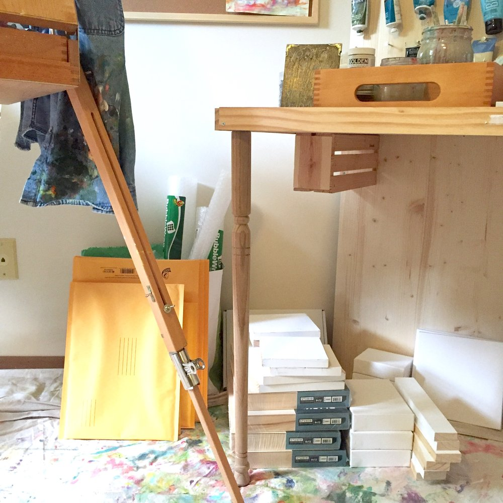 A stash of shipping supplies and canvases/wood panels in my studio!