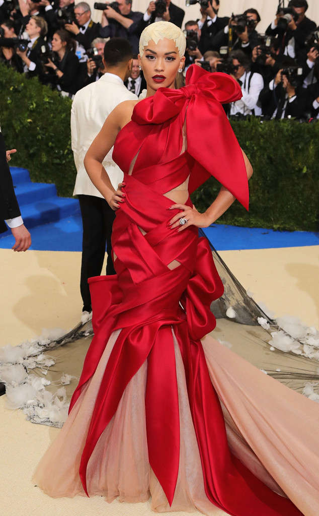 Rita Ora's quirky hairstyle added a surreal feel to this dramatic red ribbon gown.