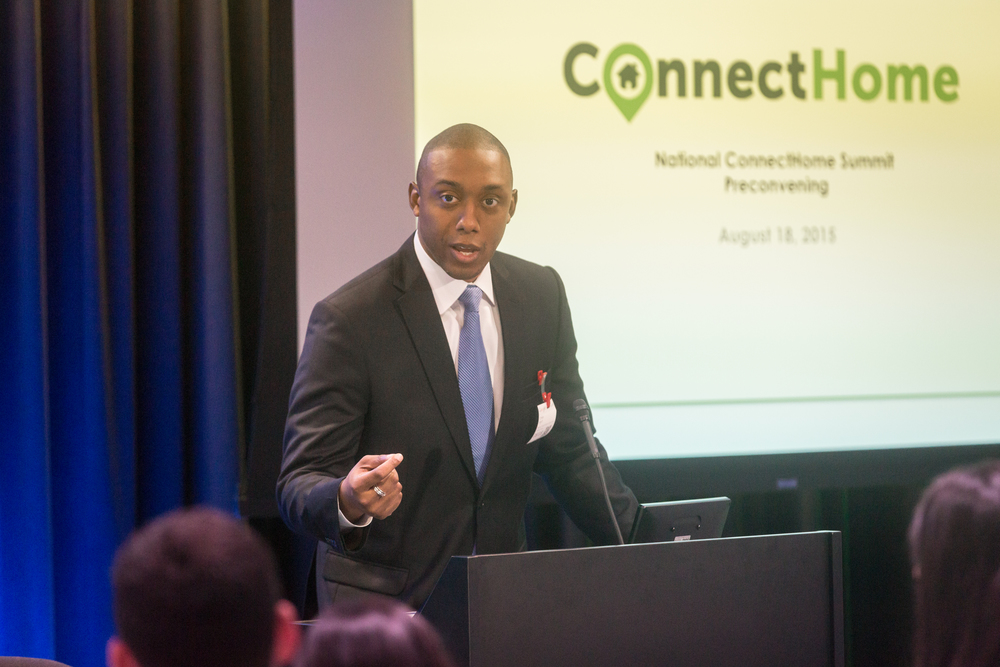 Chike Aguh, CEO of EveryoneOn, presents at the national pre-summit of ConnectHome, an Obama administration imitative to connect families living in public housing.
