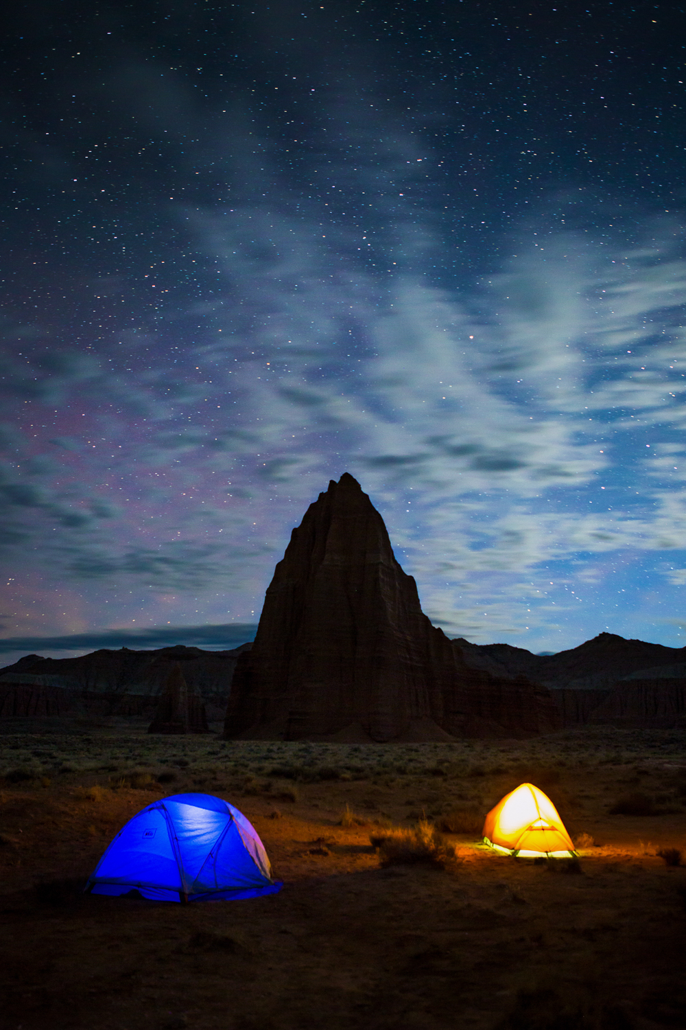 Camping at the foot of the Temple of the Sun and Moon, Capitol Reef, Utah. One of the calmest and quietest night of camping we've ever experienced. We had this all to ourselves.