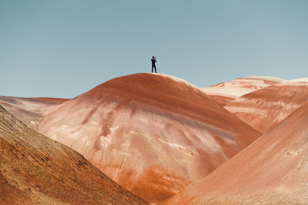 Jason on top of the painted hills in Capitol Reef, Utah