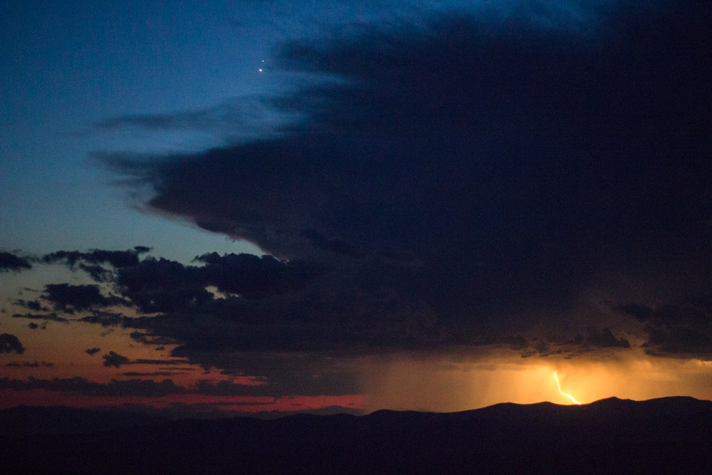 Watching a distant lightning storm atop Abercrombie Mountain after a sunset hike • Washington, USA •