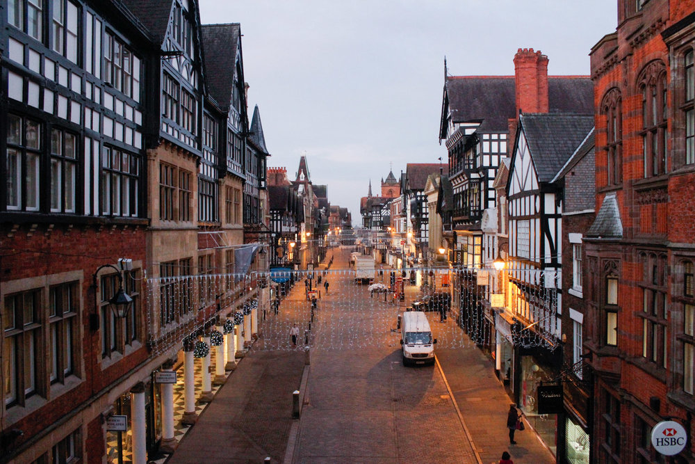 I woke up at sunrise to take this photo of my hometown before its streets filled with people. • Chester, England •