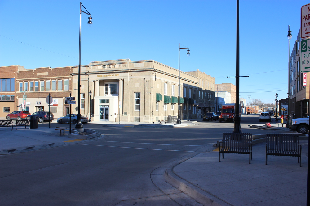 MINOT, NORTH DAKOTA. On November 12, 2015, the finished intersection at Central Avenue and Main Street in downtown featured concrete roads, new street lights, park benches, and pedestrian bump-outs. Photo courtesy of City of Minot.