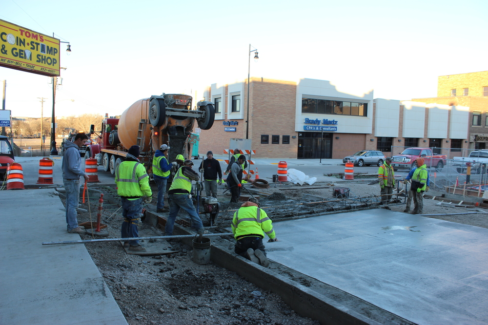 DOWNTOWN IMPROVEMENTS. On November 17, 2015, construction crews finish one of the final concrete placements to connect First Street SE to Central Avenue. In 2015 more than 32,500 square yards of concrete were used to form roads and sidewalks, the equivalent of 668 trucks. Photo courtesy of City of Minot.