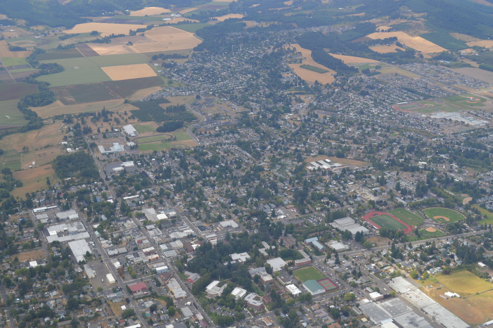 AERIAL VIEW: Once a small farm town, Forest Grove has grown and today sits on the western edge of the of the Portland metropolitan area and Willamette Valley. This aerial photos shows that the urban/agricultural boundary still persists. Photo by Amos Meron.