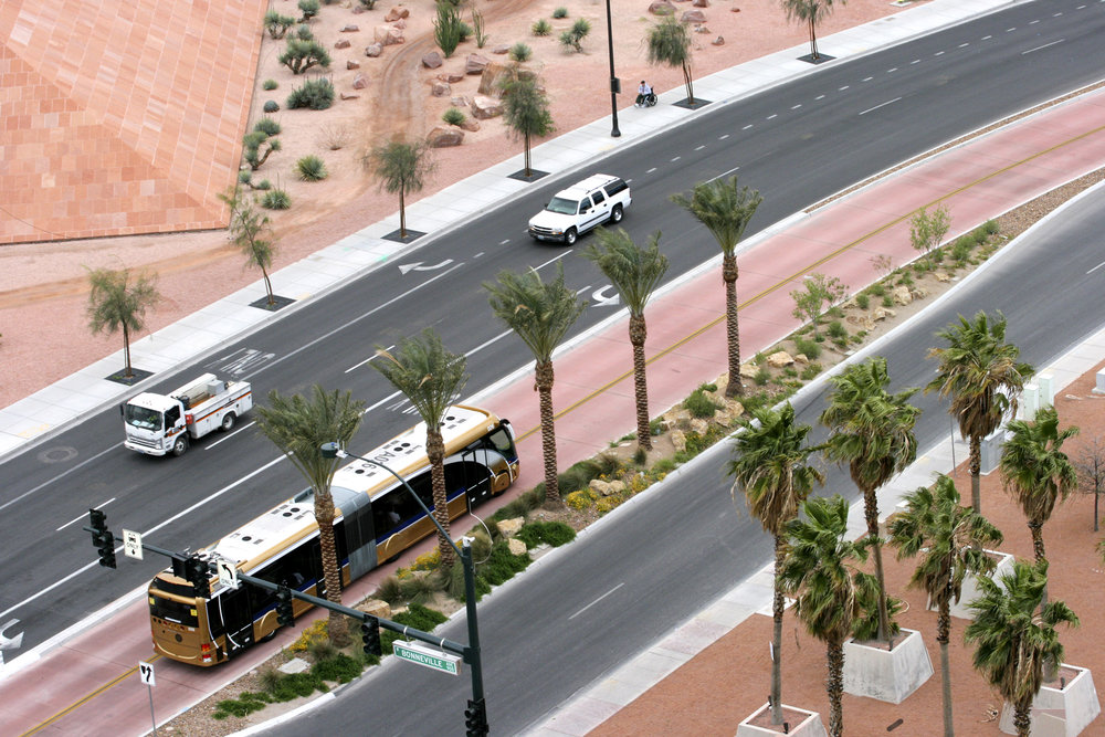 SDX Express on Fremont: One of the Regional Transportation Commission of Southern Nevada's express route vehicles stops at a new bus shelter that provides pre-pay ticket machines, solar-powered lighting and a curb-level boarding platform. Photo provided by RTC.