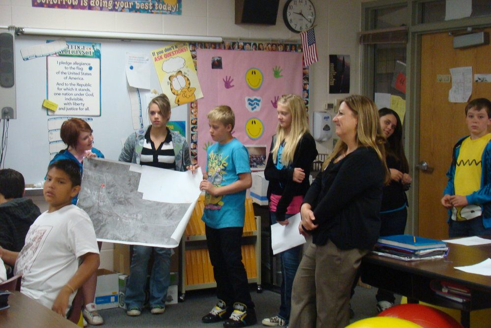 WELCOME TO PLANNING DAY: This team explains their proposed project to the class.  Photo by Paula Farley.