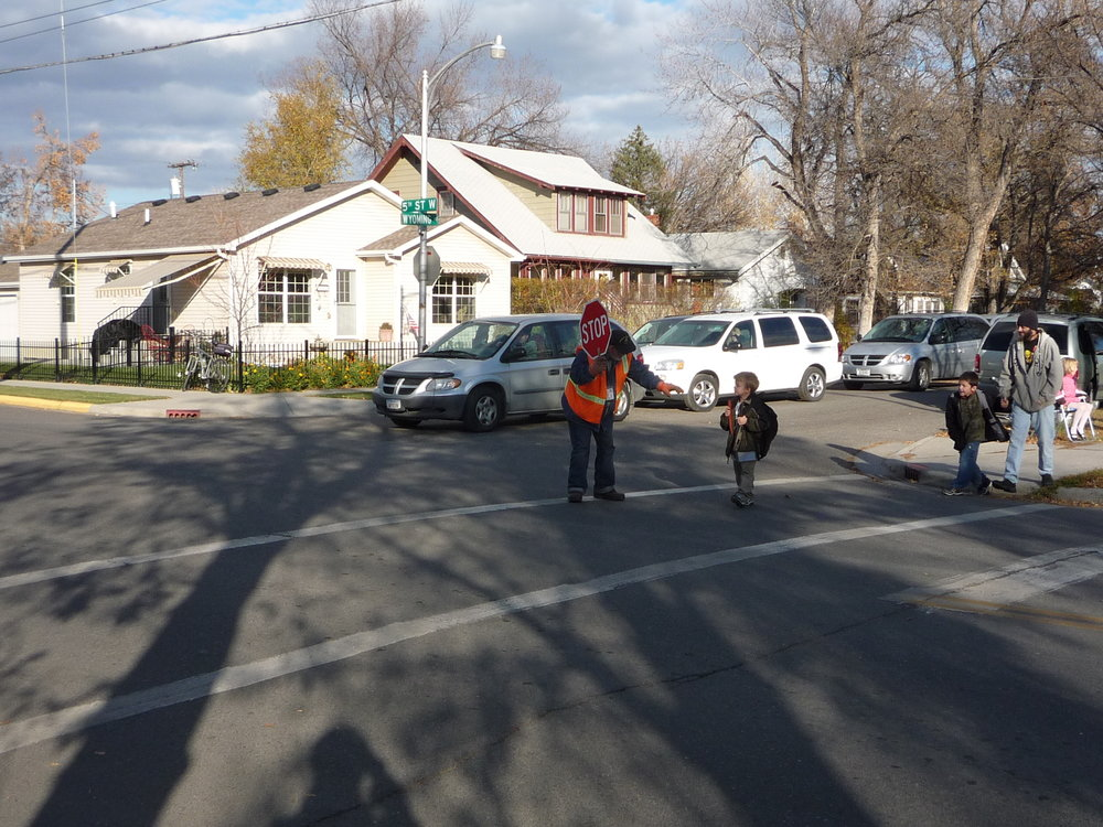 Complete Streets are Safe Routes to Schools: Students cross a street in a Billings residential neighborhood equipped with crosswalk, sidewalks and ADA ramps.  Photo courtesy of Active Transportation Alternatives, LLC.