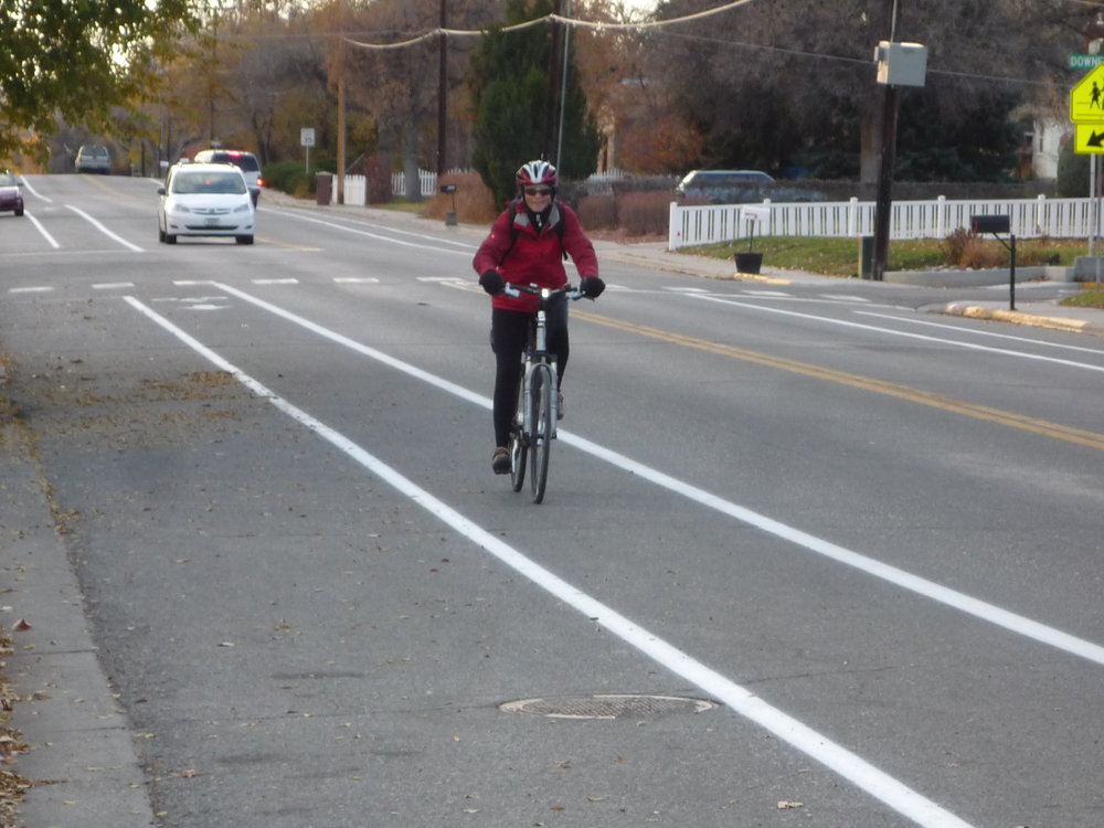 Darlene Tussing, who serves as the community alternative modes coordinator through her Active Transportation Alternatives consulting firm, commutes on one of the more than six miles of bike lanes along arterial streets in Billings. Photo courtesy of Active Transportation Alternatives, LLC.
