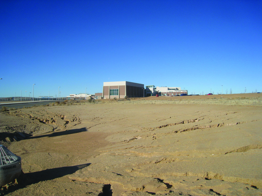 ISOLATED FROM ITS COMMUNITY: ACCORDING TO THE PASEO GATEWAY MASTER PLAN, THE AREA AROUND THE NEW SUE CLEVELAND HIGH SCHOOL IN RIO RANCHO, NEW MEXICO WILL EVENTUALLY DEVELOP WITH A MIX OF RESIDENTIAL AND EMPLOYMENT OPPORTUNITIES. SOURCE: NEW MEXICO PUBLIC SCHOOL FACILITIES AUTHORITY.