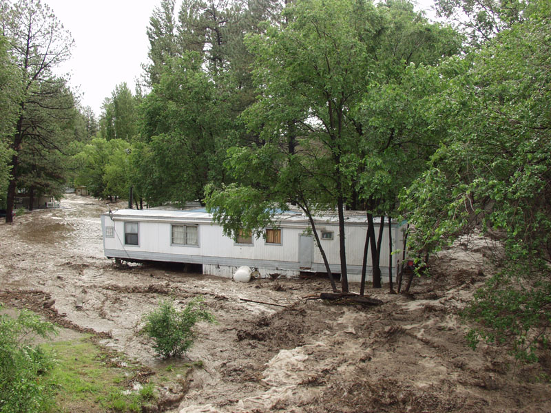 The power of flash flooding in the mountain town of Ruidoso, New Mexico in 2008. Photo courtesy of New Mexico Floodplain Managers Association.