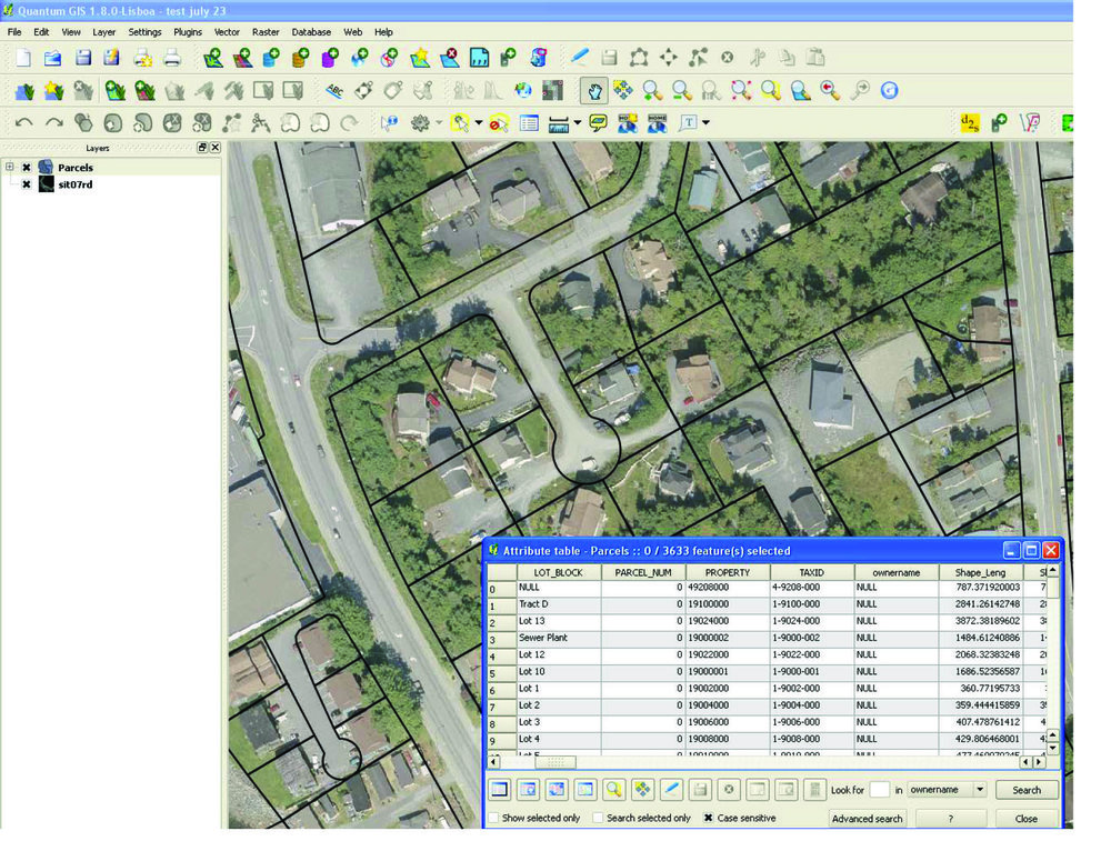QGIS: A screenshot of QGis with parcel layer and attribute table.