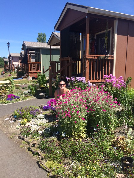 Beautiful gardens are planted in front of the tiny homes at Quixote Village.  Photo Credit:  Panza.   .