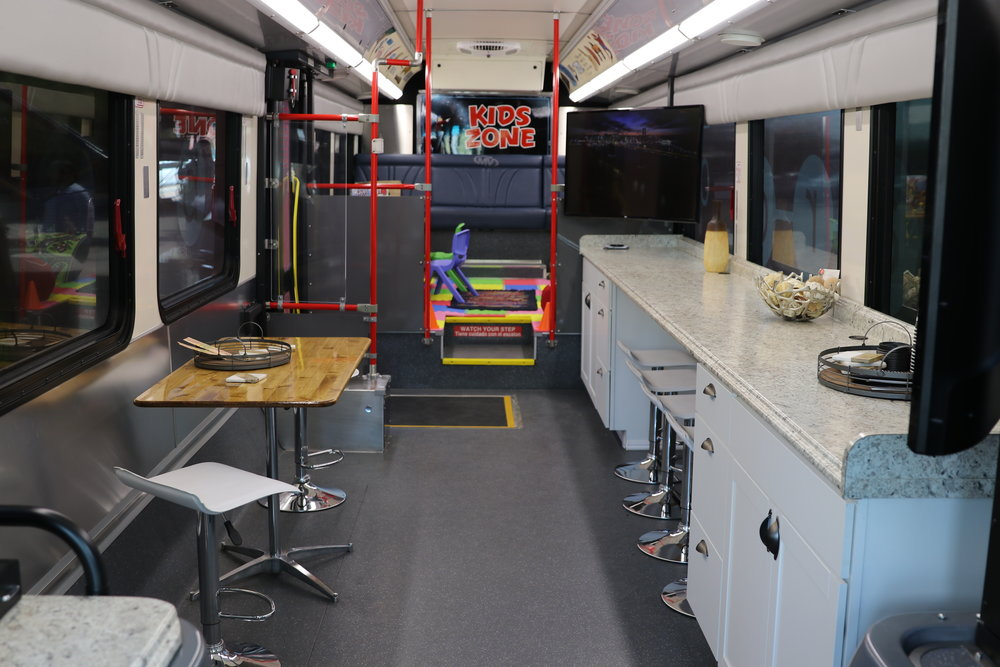 The bus includes seating and countertops to accommodate iPad workstations for residents to take a short survey (in English and Spanish) and two wide-screen monitors for presentations. Photo provided by RTC.