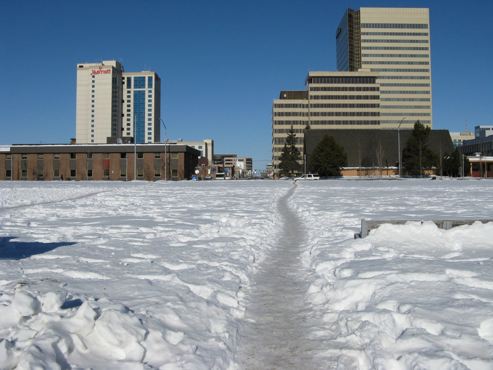 The Park Strip in Downtown Anchorage: Ad-hoc pedestrian footpaths appear every winter between the separated residential and commercial areas of downtown; visually illustrating a continuous community need to connect with the downtown area. Photo by Carla Burkhead.