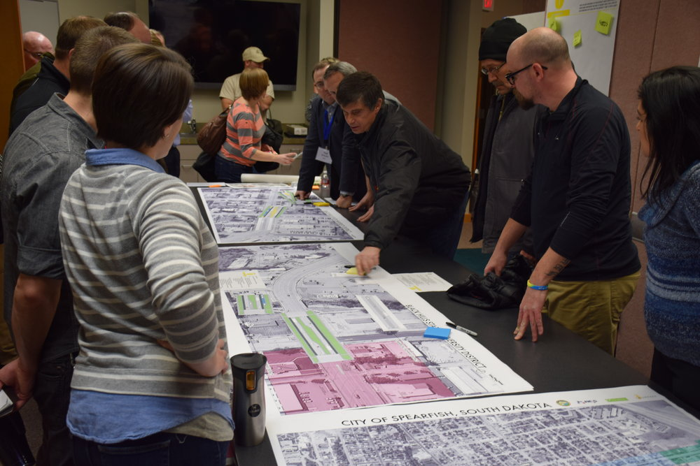 Residents use templates to discuss options.  Photo by Matt Fridell/Tallgrass Landscape Architecture.