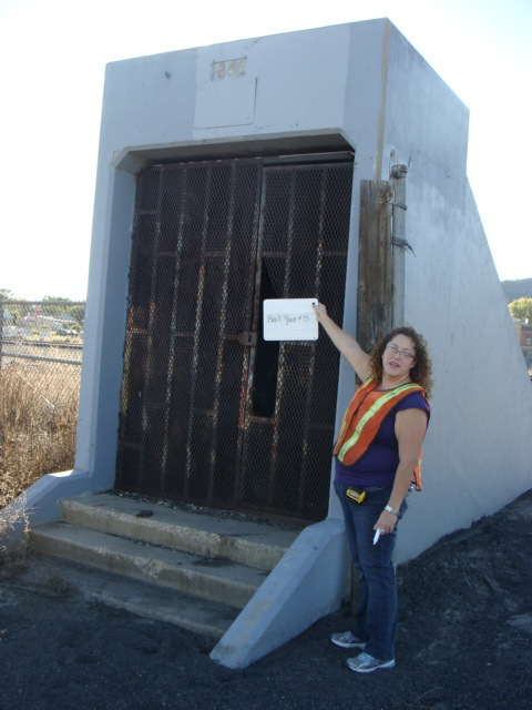 The entrance to one of the tunnels that once allowed pedestrians safe passage beneath the railroad tracks that bisect Raton. The evaluators used whiteboards to identify locations of photos. Photo Credit: Patricia Walsh.