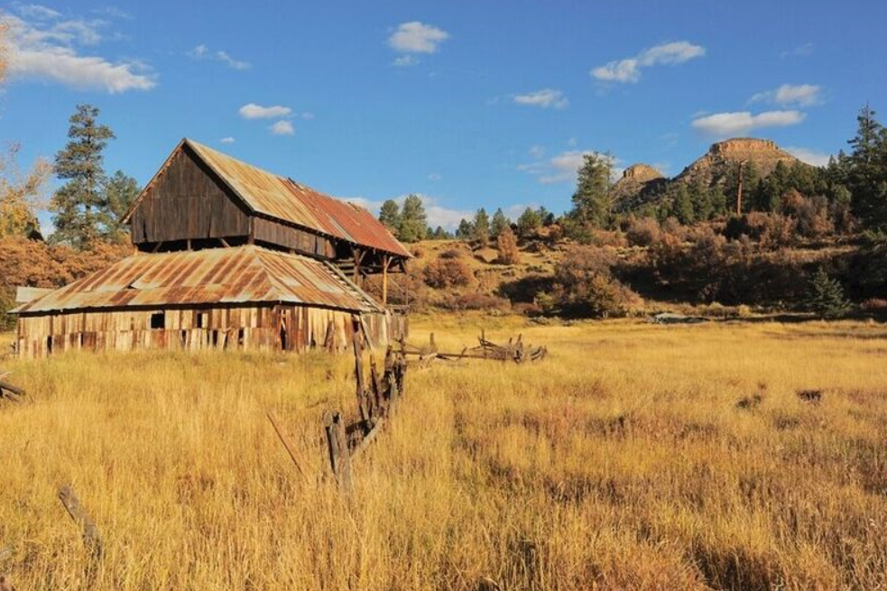 The barn from when Twin Butte was the McIntyre Ranch, with the real buttes in the background. Photo courtesy of Terri Pauls.