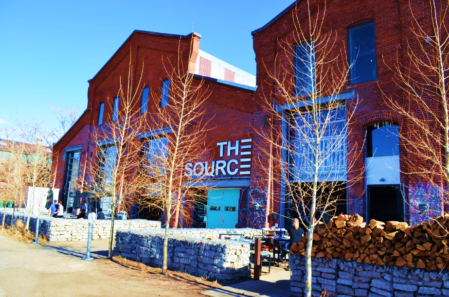 FIGURE 2 - THE SOURCE, DENVER, COLORADO.  RIVER NORTH ARTS DISTRICT WAS ONE OF THE FIRST PIONEERING REVITALIZATIONS IN THIS INDUSTRIAL DISTRICT TURNED ARTS MECCA.  THIS FORMER FOUNDRY IS NOW HOME TO A VARIETY OF RESTAURANTS, FOOD VENDORS, A FLOWER SHOP AND BREWERY.