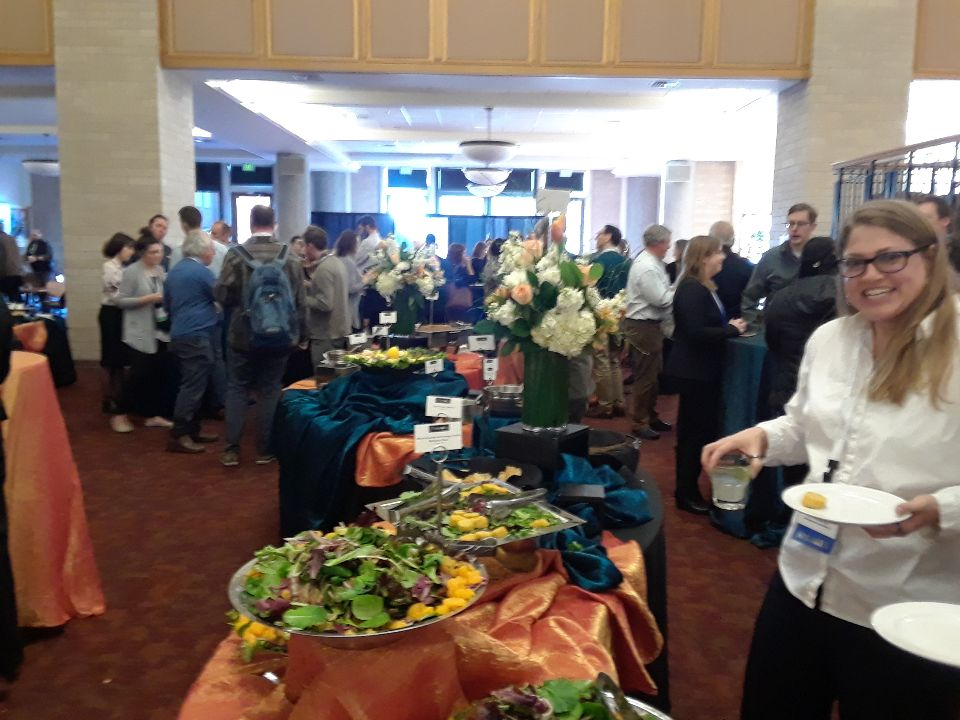 Folks enjoy great food at the reception after a full day of sessions at the 28th Rocky Mountain Land Use Institute, held at the University of Denver Sturm College of Law.