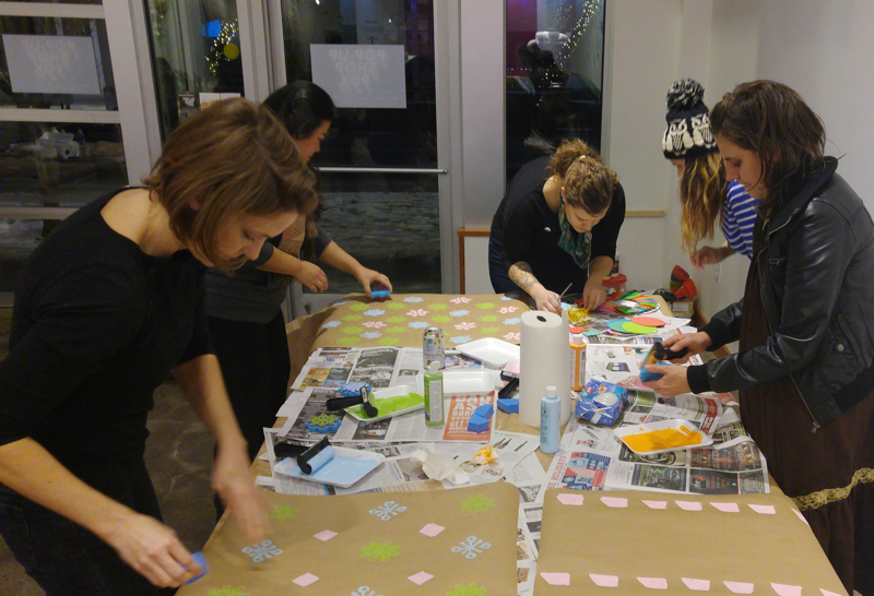 Students finished out the evening making handprinted gift wrap