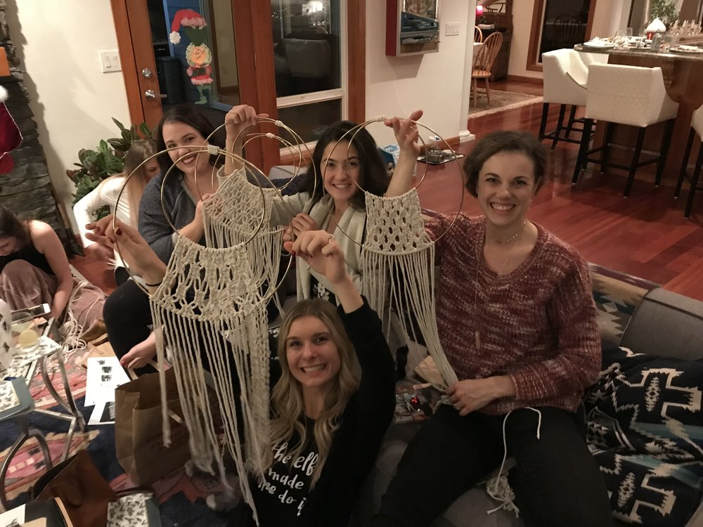 A company holiday staff party featuring macrame wall hangings