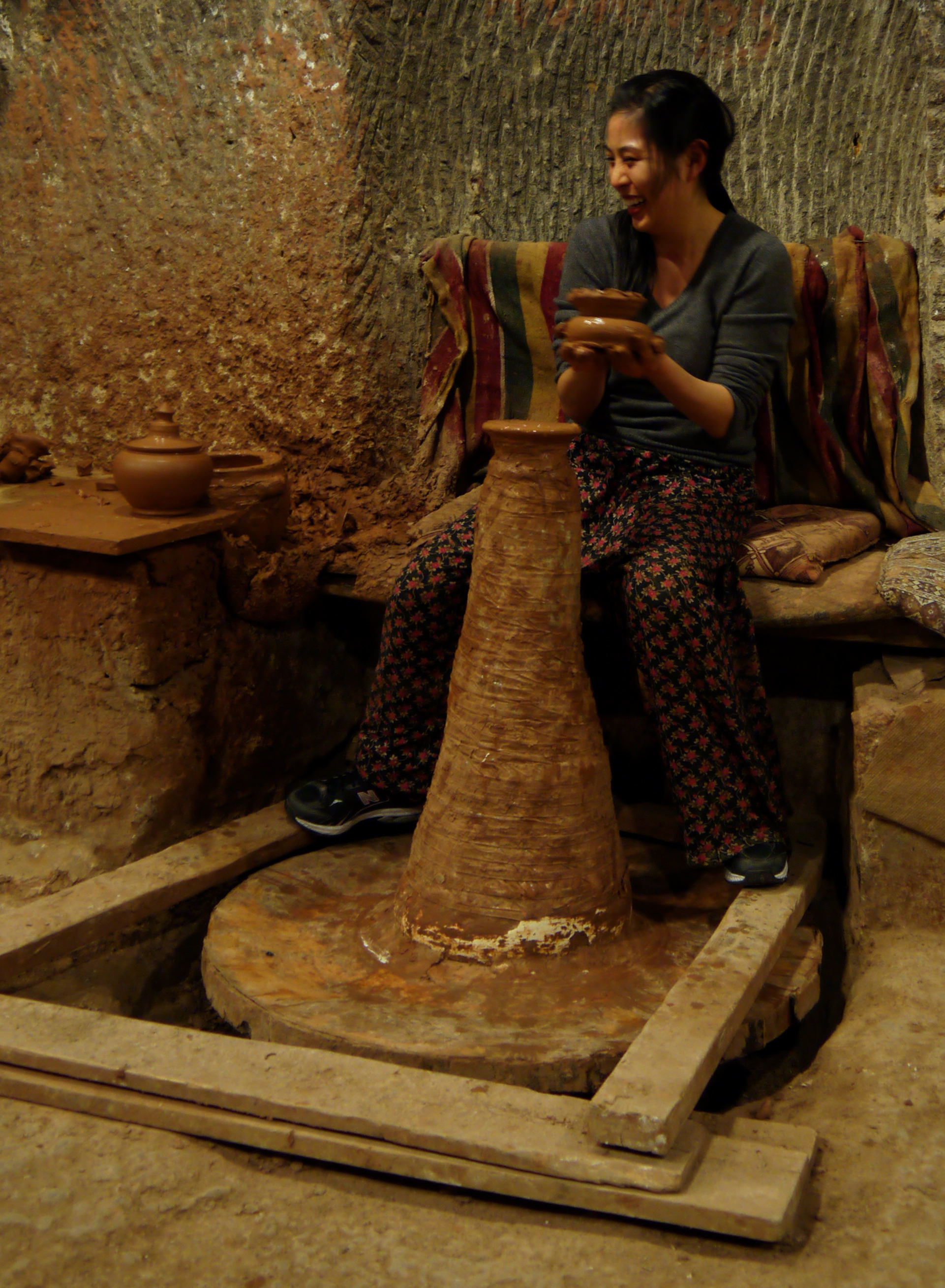 Figure 5. Jennifer working on red clay pottery