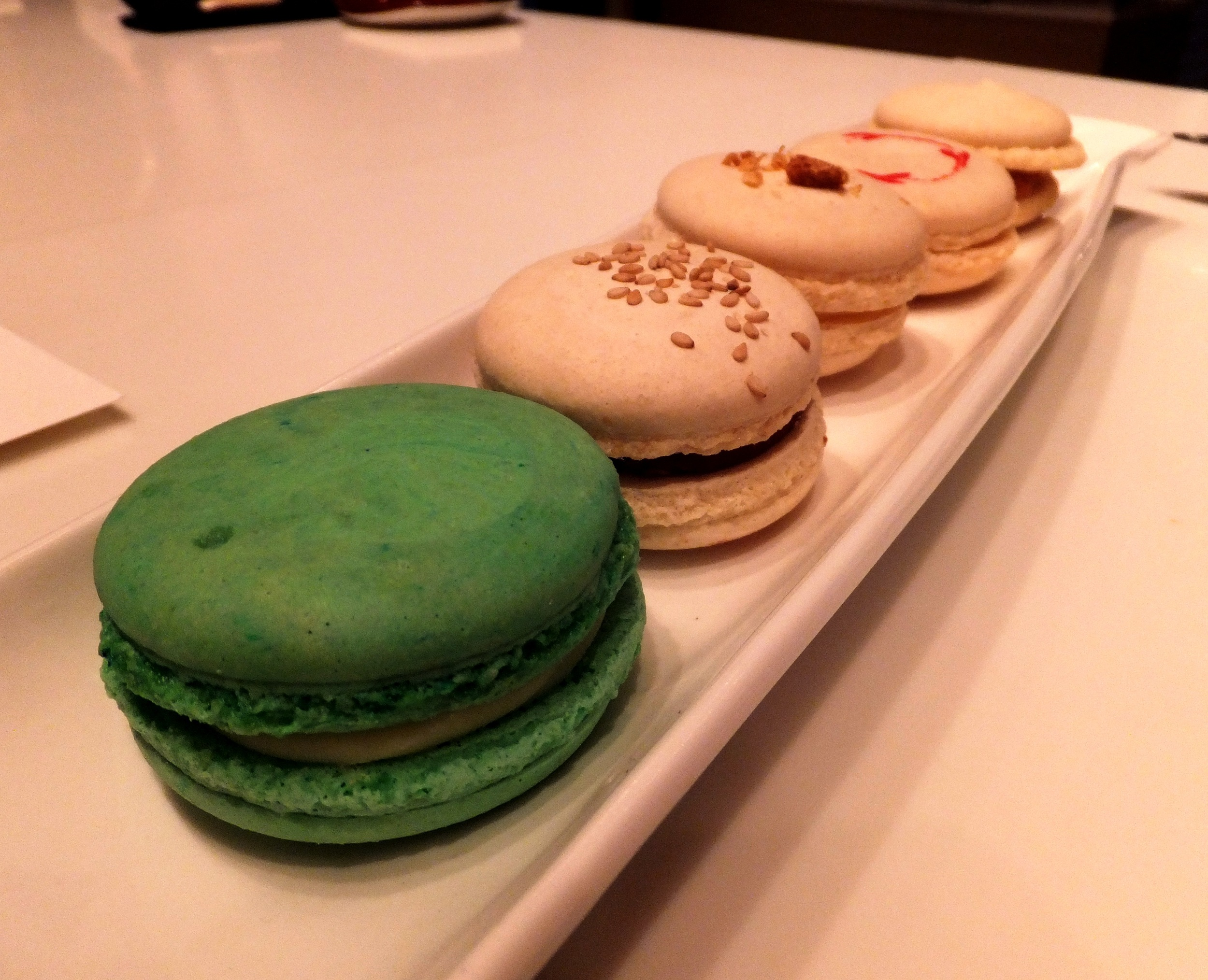 Figure 9. Macaroon flight of (from front) oba, chocolate-sesame, red bean, yuzu, and caramel soy macaroons
