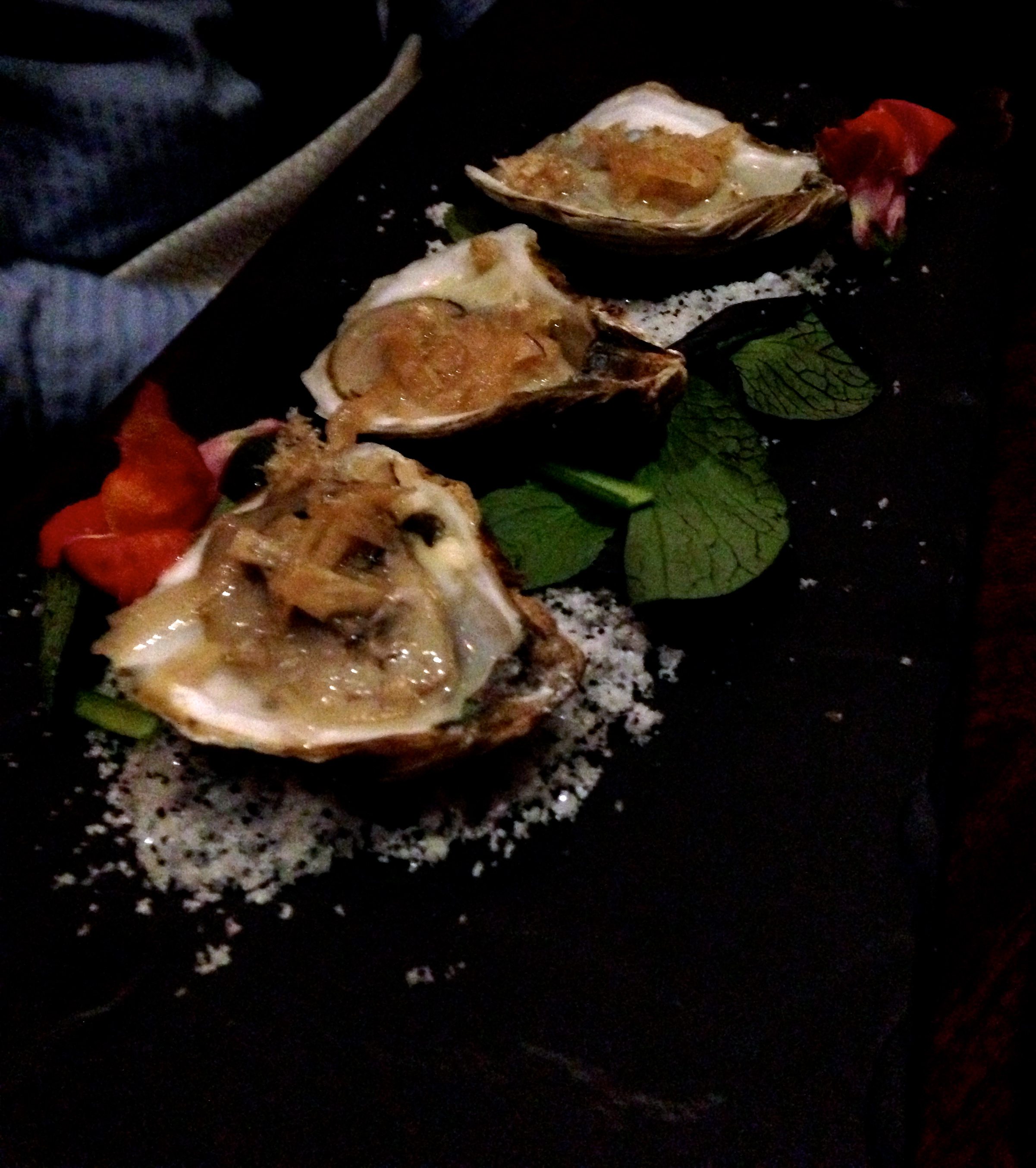 Figure 4. Naked cowboy oysters with hoppy pickled radishes and chicharrones