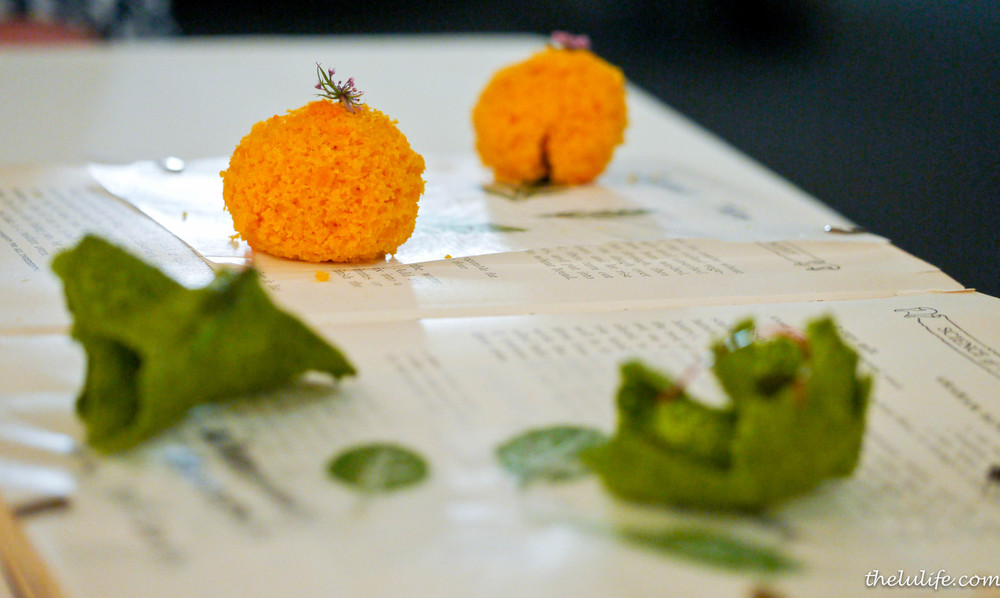Amuse Bouche #4: Carrot cake and savory kale chips on a book with photos from the garden As we carefully picked up these intricate, fluffy carrot cakes, we were able to flip through the book and see the gorgeous garden Meadowood keeps.  What a creative idea to serve an amuse bouche!