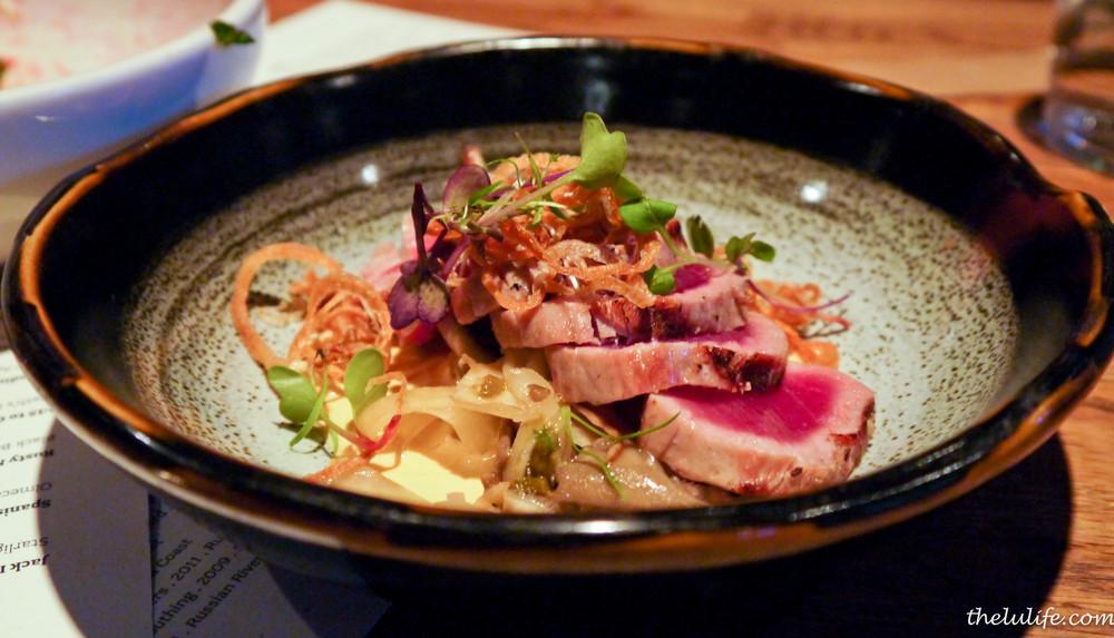Grill seared ahi tuna with smoked uni cream and padron pepper-mushroom salad