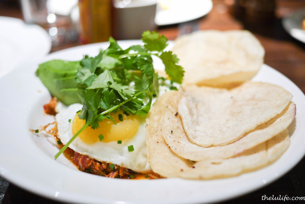 Spicy chicken tinga - guajillo chili, sunny eggs, avocado, corn tortilla