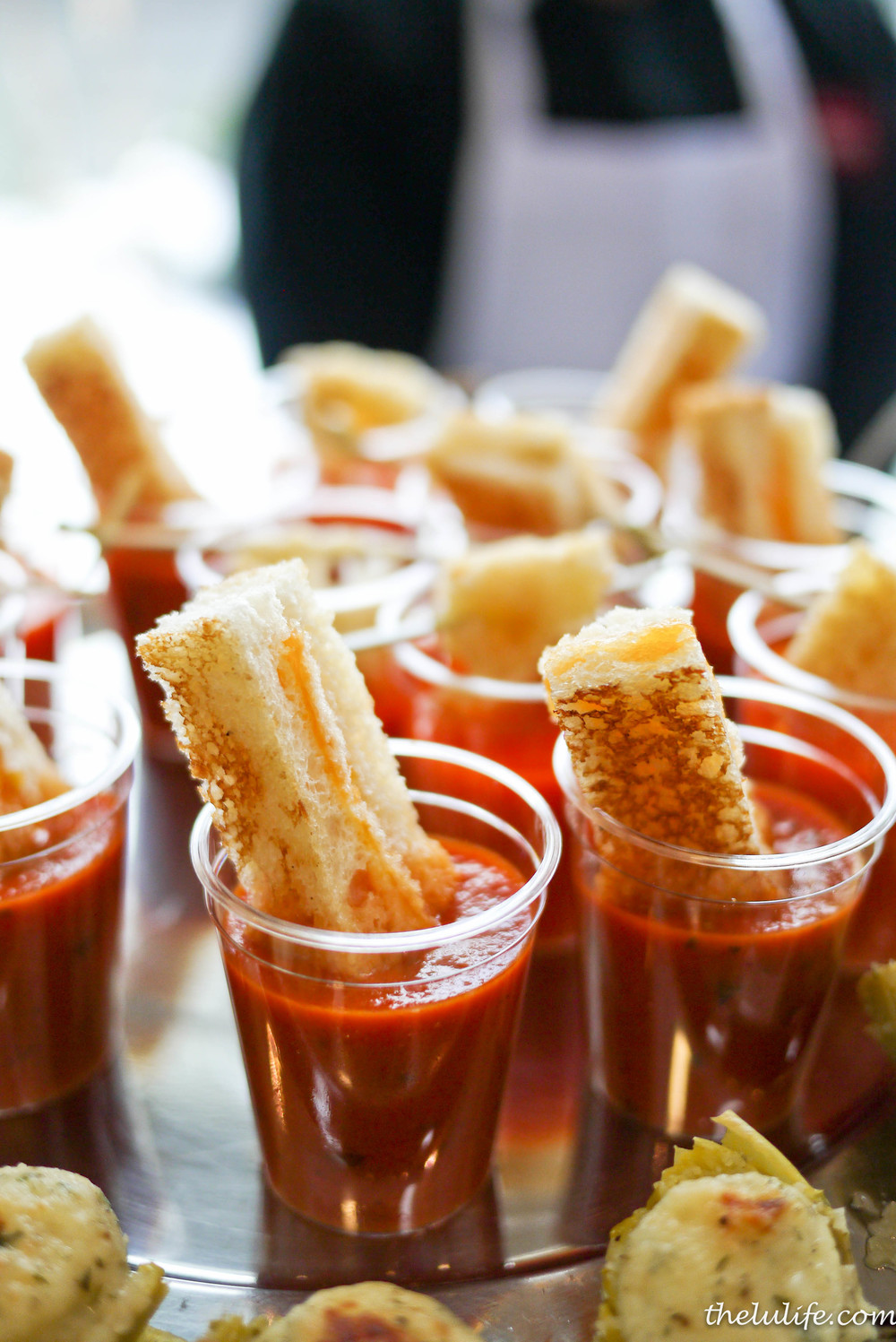 Grilled cheddar stick and tomato basil soup with basil chiffonade