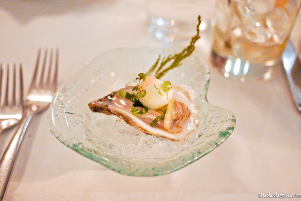 Champagne vinegar sorbet over French-kissed oyster from New Brunswick